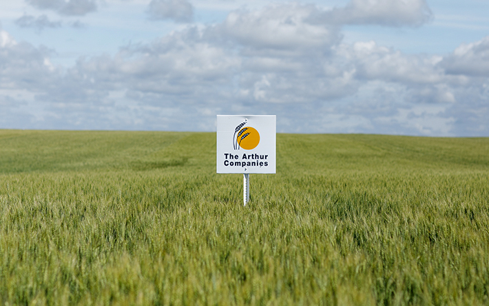 Arthur Companies Sign in Wheat Field