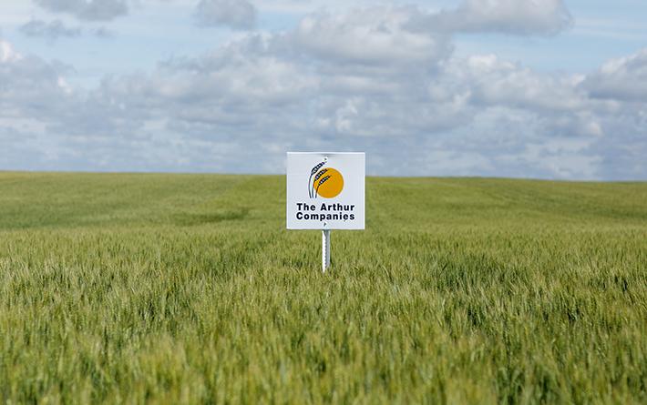 Arthur Companies Sign in Wheat Field